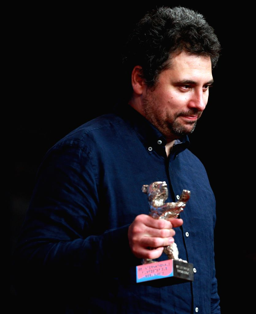 """Director Radu Jude holds his Silver Bear for the Best Director for his film """"Aferim!"""" during a news conference after the awarding ceremony of the 65th ..."""