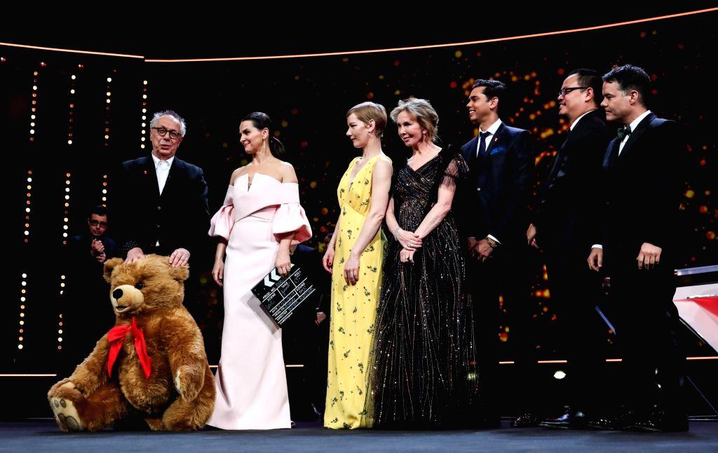 BERLIN, Feb. 17, 2019 - Berlinale director Dieter Kosslick (L) receives a stuffed bear from members of the Berlinale 2019 Jury during the awards ceremony of the 69th Berlin International Film ... - Dieter Kosslick