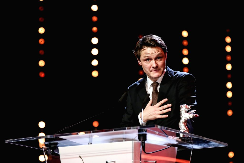 """BERLIN, Feb. 17, 2019 - Cameraman Rasmus Videbaek receives the Silver Bear for Outstanding Artistic Contribution award for """"Out Stealing Horses"""" during the awards ceremony of the 69th ..."""