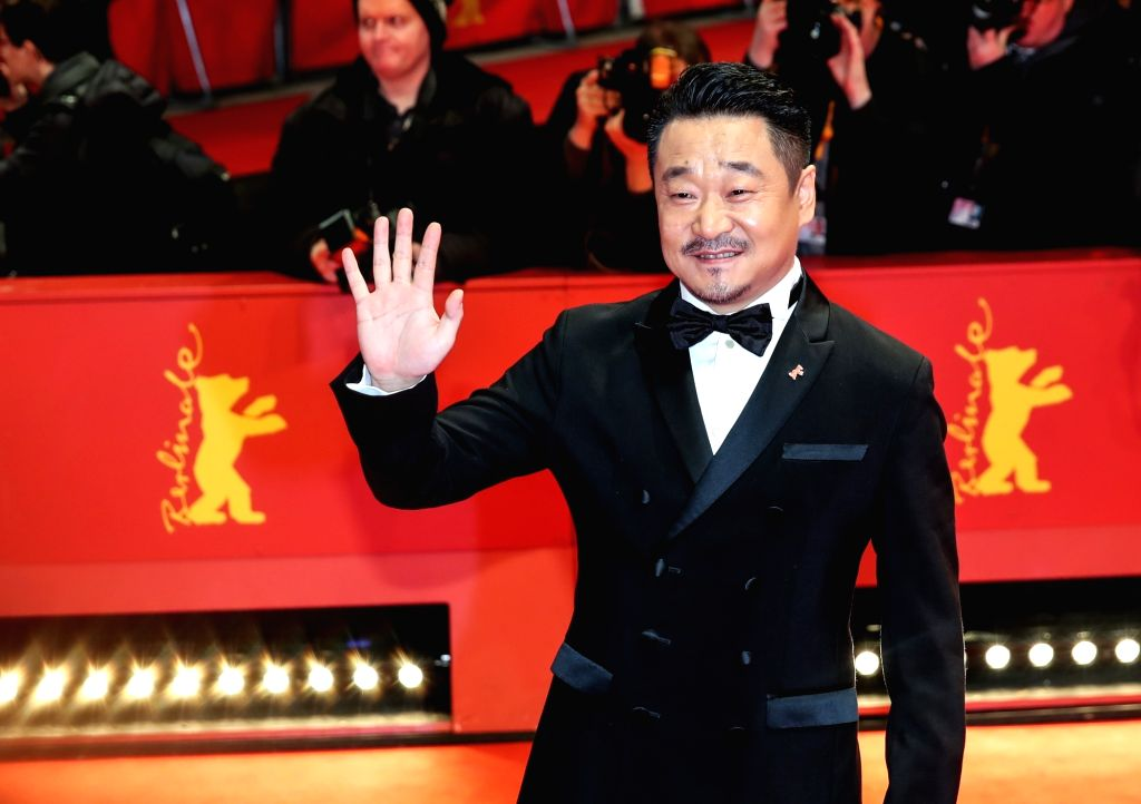 BERLIN, Feb. 17, 2019 - Chinese actor Wang Jingchun poses for photos on the red carpet prior to the award ceremony of the 69th Berlin International Film Festival in Berlin, capital of Germany, Feb. ... - Wang Jingchun