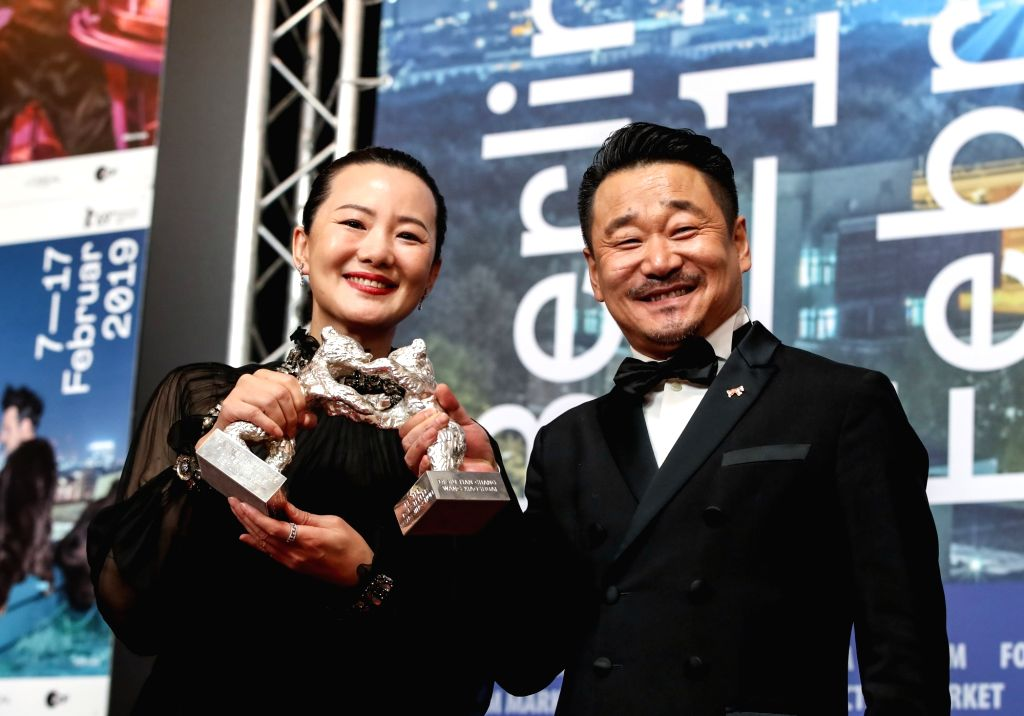 BERLIN, Feb. 17, 2019 - Chinese actor Wang Jingchun (R) and actress Yong Mei pose for photos during a press conference of the 69th Berlin International Film Festival in Berlin, capital of Germany, ... - Wang Jingchun