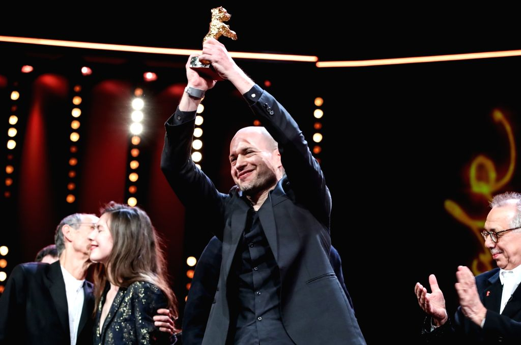 """BERLIN, Feb. 17, 2019 - Director Nadav Lapid (C) receives the Golden Bear for Best Film award for """"Synonymes"""" (Synonyms) during the awards ceremony of the 69th Berlin International Film ..."""