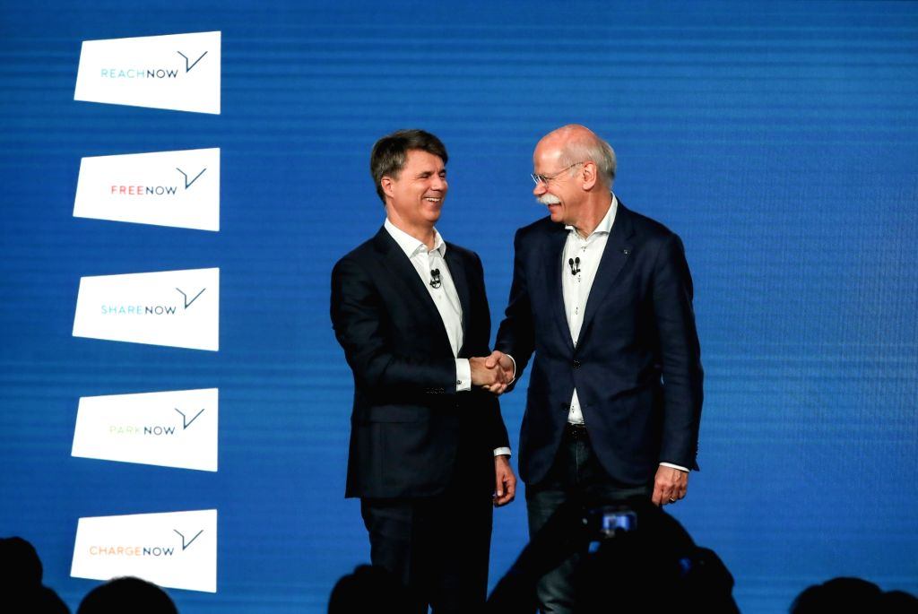 BERLIN, Feb. 22, 2019 - Harald Krueger (L), management board chairman of BMW, shakes hands with Dieter Zetsche, chairman of the board of management of Daimler, after a press conference in Berlin, ...