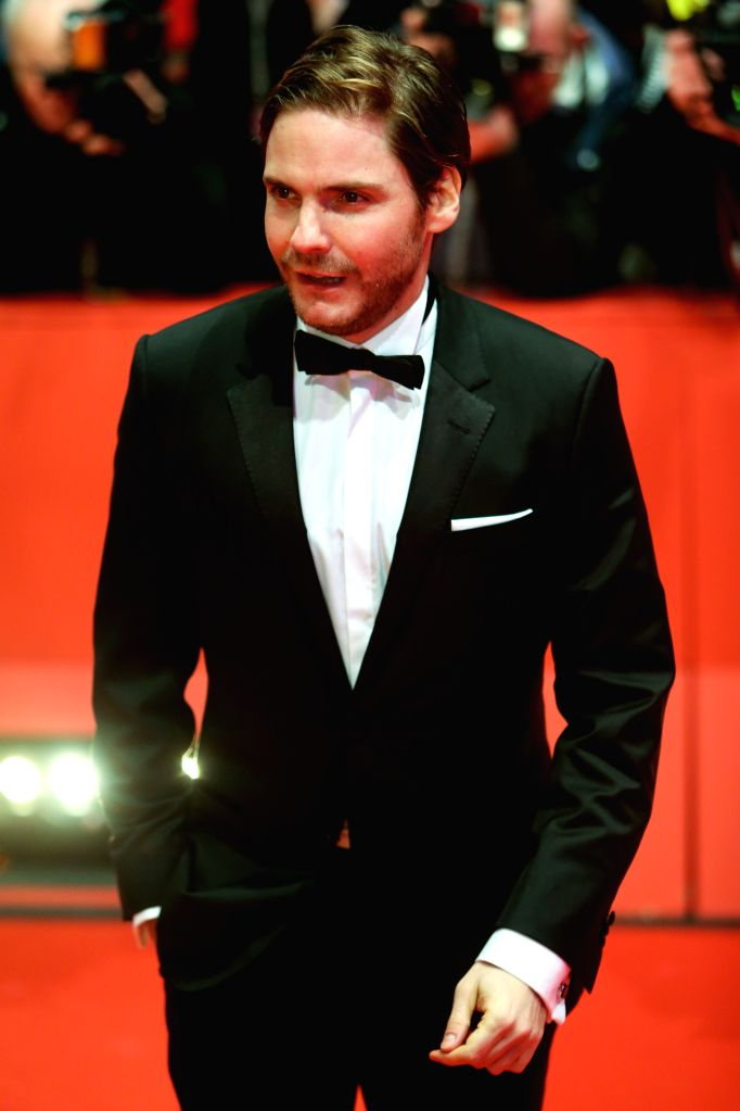 Actor Daniel Bruehl poses for photos on the red carpet prior to the opening ceremony at the 65th Berlinale International Film Festival in Berlin, Germany, on Feb. 5, . - Daniel Bruehl