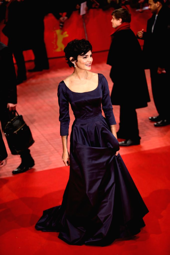 Actress Audrey Tautou poses for photos on the red carpet prior to the opening ceremony at the 65th Berlinale International Film Festival in Berlin, Germany, on Feb. .. - Audrey Tautou