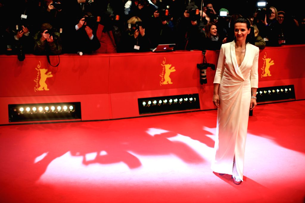 Actress Juliette Binoche poses for photos on the red carpet prior to the opening ceremony at the 65th Berlinale International Film Festival in Berlin, Germany, on ... - Juliette Binoche