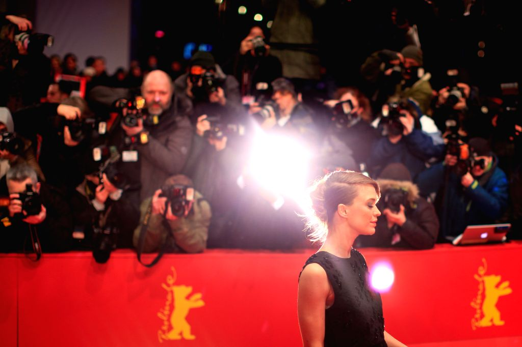 German Actress Heike Makatsch poses for photos on the red carpet prior to the opening ceremony at the 65th Berlinale International Film Festival in Berlin, Germany, .. - Heike Makatsch