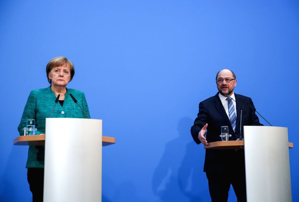 BERLIN, Feb. 7, 2018 - German Chancellor and leader of German Christian Democratic Union (CDU) Angela Merkel (L) and er of German Social Democratic Party (SPD) Martin Schulz attend a joint press ...