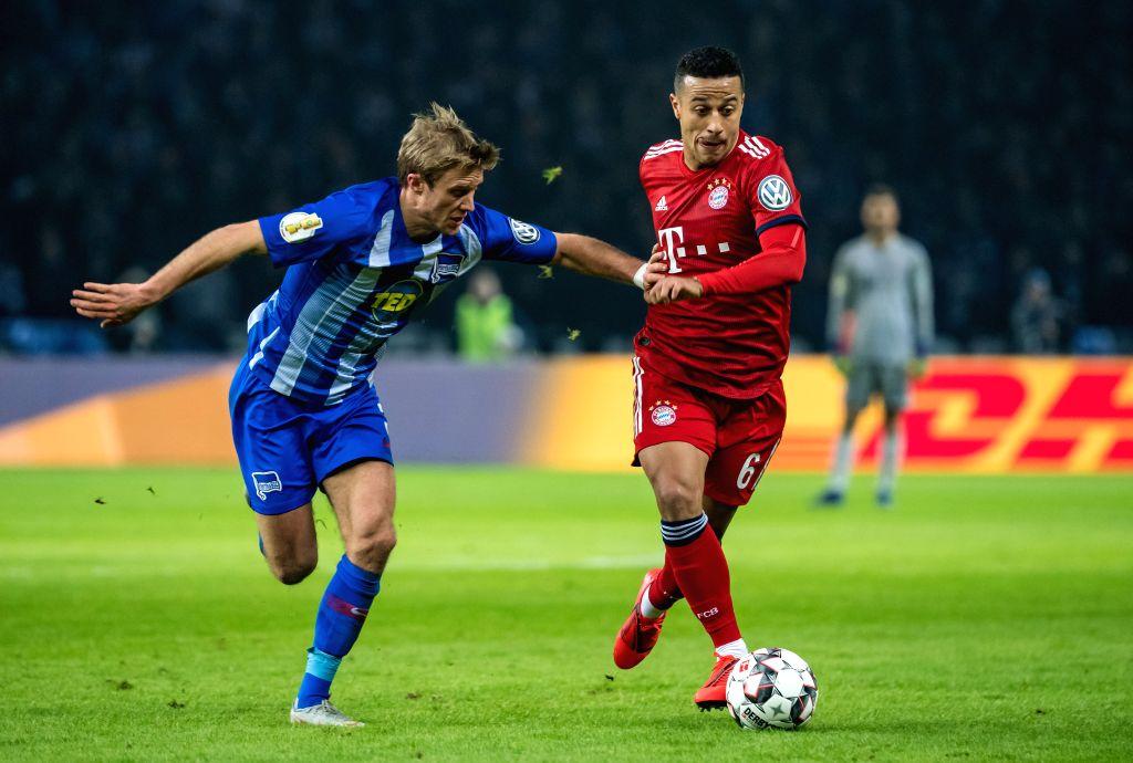 BERLIN, Feb. 7, 2019 - Bayern Munich's Thiago Alcantara (R) vies with Hertha's Per Ciljan Skjelbred during the DFB Cup third round match between Hertha BSC and Bayern Munich, in Berlin, capital of ...
