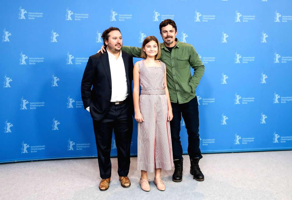 "BERLIN, Feb. 9, 2019 - Director, screenwriter and actor Casey Affleck (R), actress Anna Pniowsky (C) and producer Teddy Schwarzman of film ""Light of My Life"" pose in a photocall during the ... - Casey Affleck"