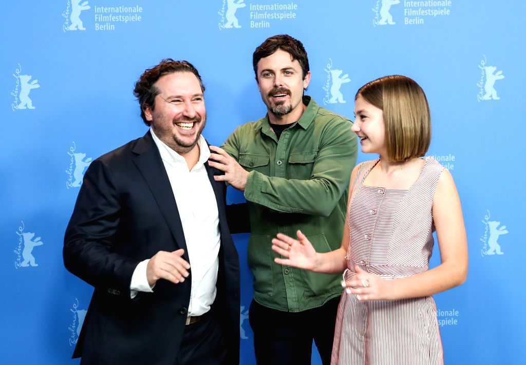 "BERLIN, Feb. 9, 2019 - Director, screenwriter and actor Casey Affleck (C), actress Anna Pniowsky (R) and producer Teddy Schwarzman of film ""Light of My Life"" interact in a photocall during ... - Casey Affleck"