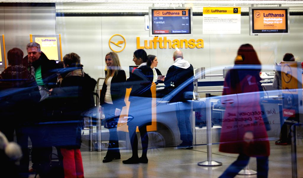 Berlin (Germany): Passengers gather near Lufthansa's check-in desks in Tegel airport, Berlin, Germany, on Dec. 1, 2014.   German airline Lufthansa said on Monday that it had canceled nearly half of ..