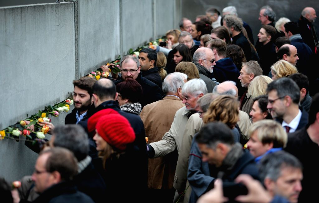 Berlin (Germany): People attend a memorial activity to commemorate the 25th anniversary of the fall of the Berlin Wall in Berlin, Germany, on Nov. 9, 2014.