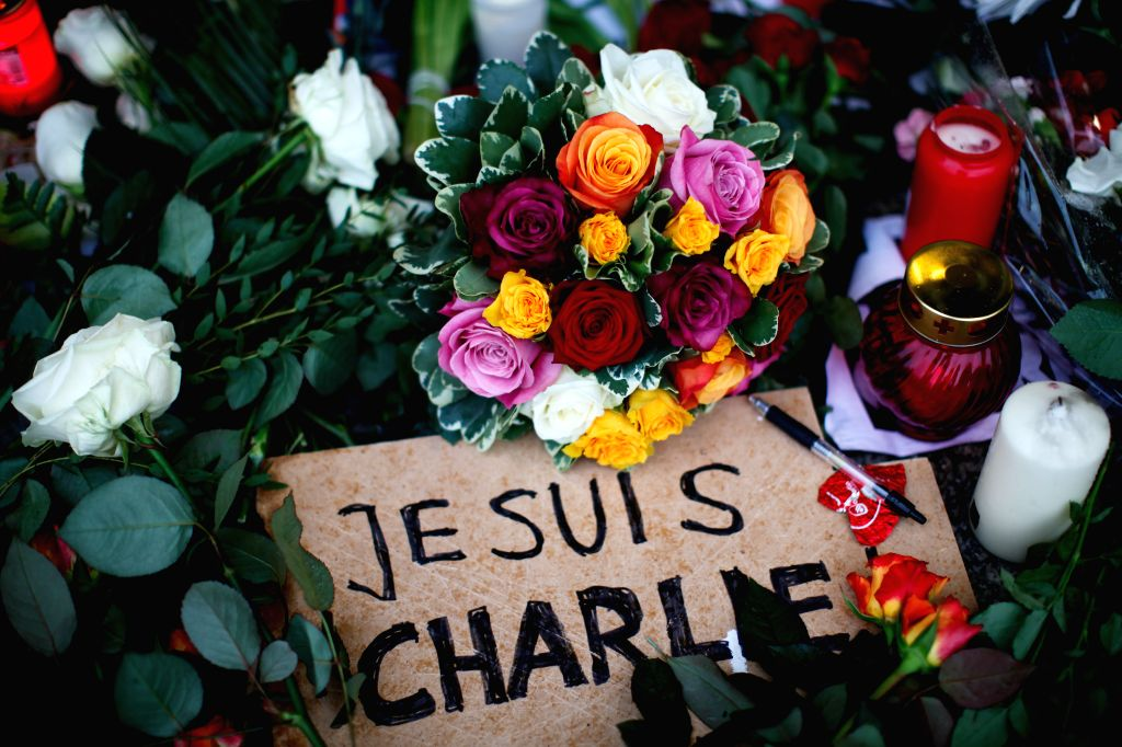 """Flowers, candles, a pen and a poster saying """"I am Charlie"""" are laid in front of the French Embassy in Berlin to commemorate the victims of the attack on ..."""