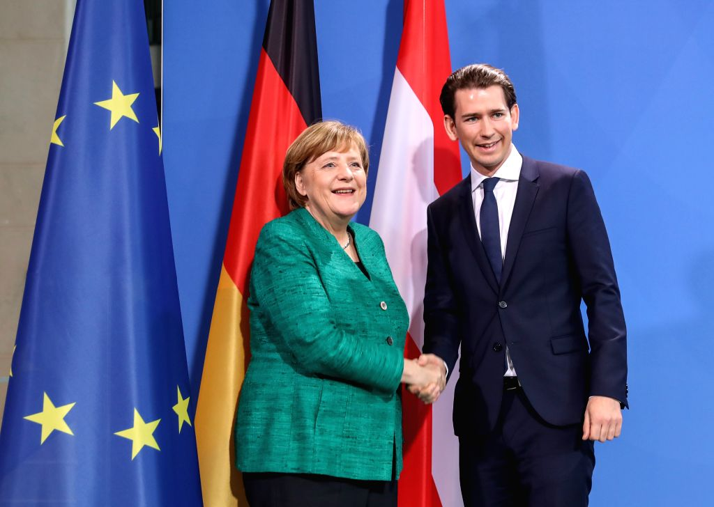 BERLIN, Jan. 17, 2018 - German Chancellor Angela Merkel (L) shakes hands with Austria's Chancellor Sebastian Kurz after a joint press conference in Berlin, capital of Germany, on Jan. 17, 2018.