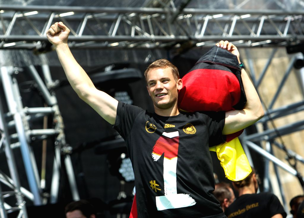 German football player Manuel Neuer waves his fist during celebration to mark the team's 2014 Brazil World Cup victory in Berlin, Germany, July 15, 2014. Germany's ..