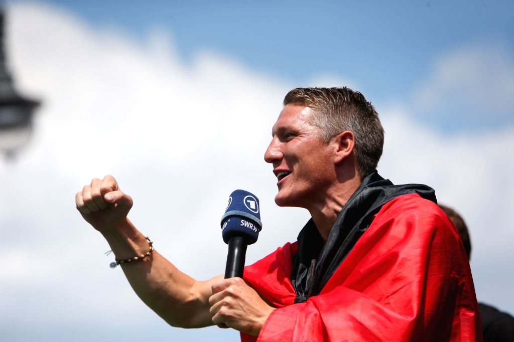 German football player Bastian Schweinsteiger gestures during celebration to mark the team's 2014 Brazil World Cup victory in Berlin, Germany, July 15, 2014. ...