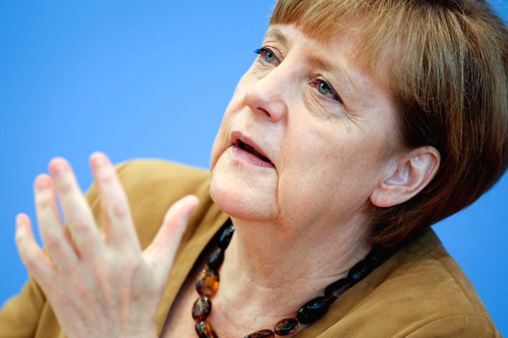 German Chancellor Angela Merkel speaks during a press conference in Berlin, Germany, on July 18, 2014. German Chancellor Angela Merkel called for ceasefire in ...