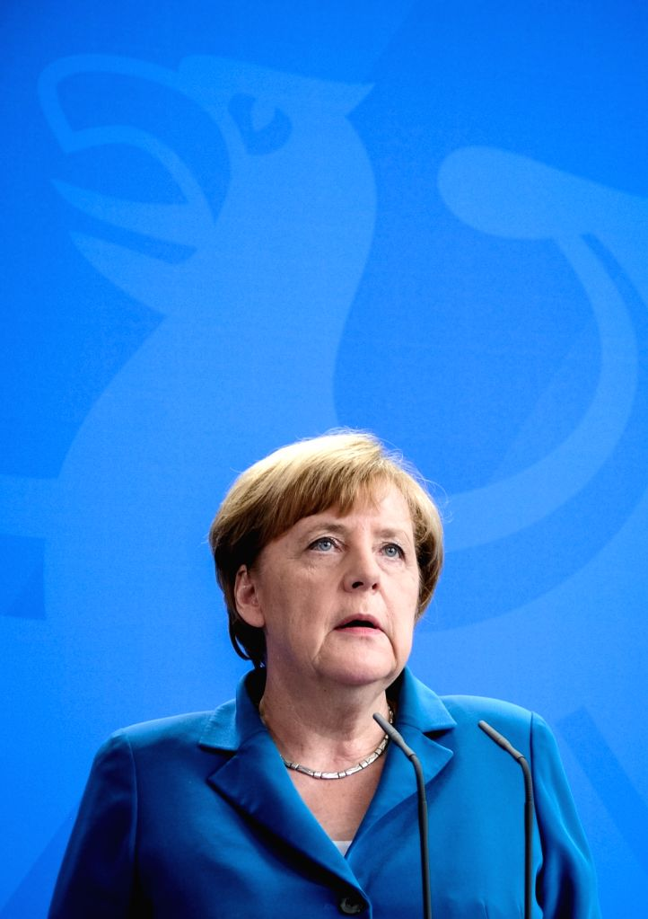 """BERLIN, July 23, 2016 - German Chancellor Angela Merkel attends a press conference in Berlin, capital of Germany, on July 23, 2016. """"With heavy heart, we all mourn with the families,"""" said ..."""