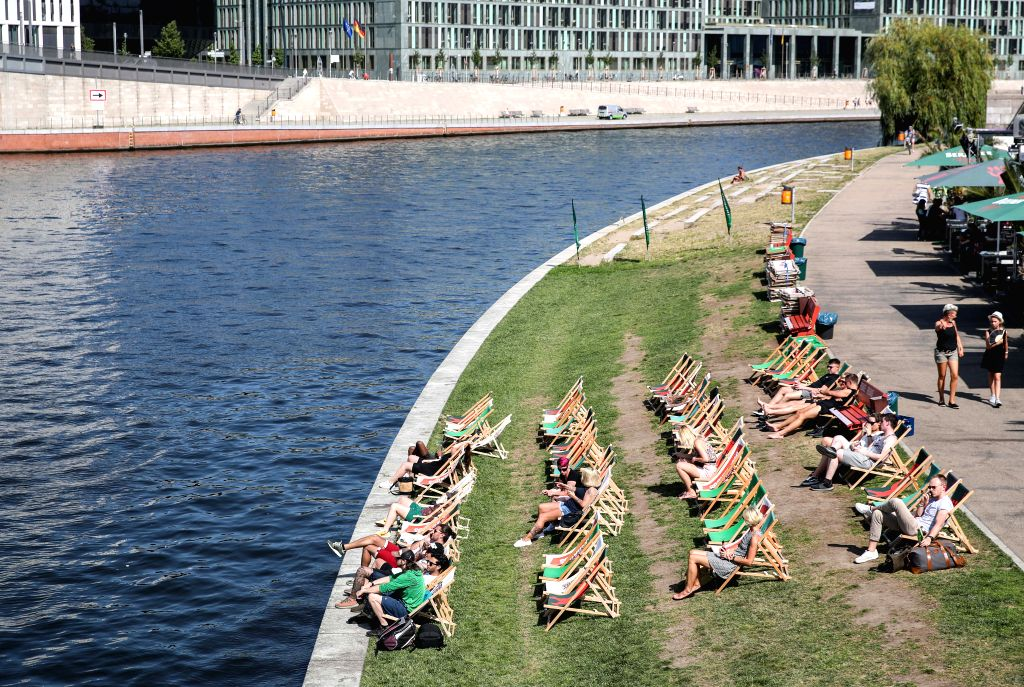 BERLIN, July 25, 2019 - People rest at the bank of the Spree river in Berlin, capital of Germany, on July 25, 2019. The German Weather Service (DWD) issued a comprehensive heat warning on Wednesday. ...