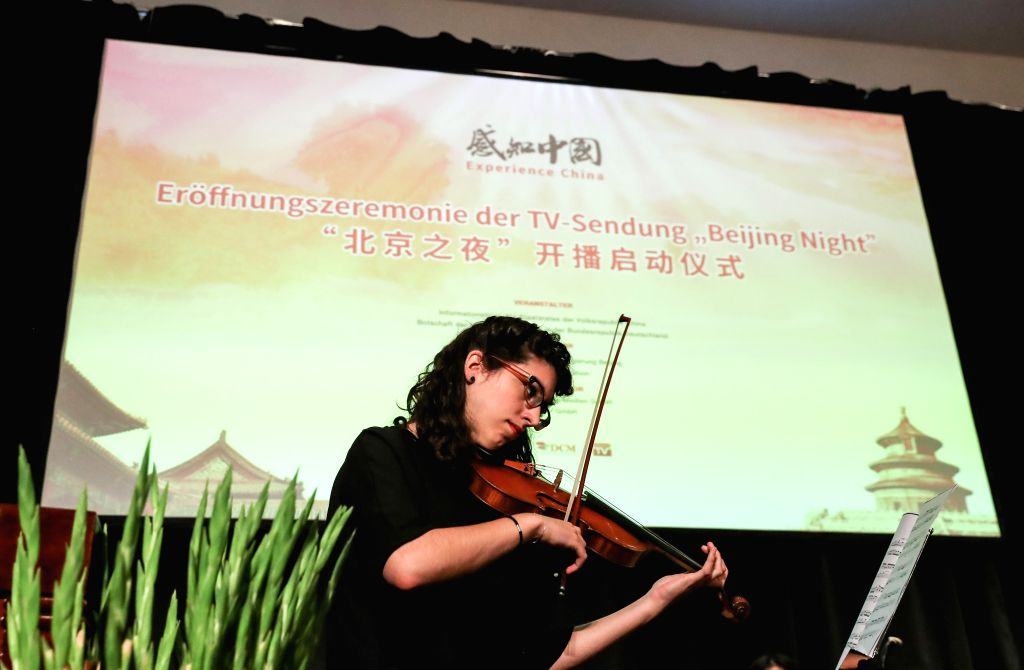 """BERLIN, July 3, 2017 - A violinist performs during the launching ceremony of documentary """"Beijing Night"""" in Berlin, capital of Germany, on July 3, 2017. The documentary """"Beijing ..."""