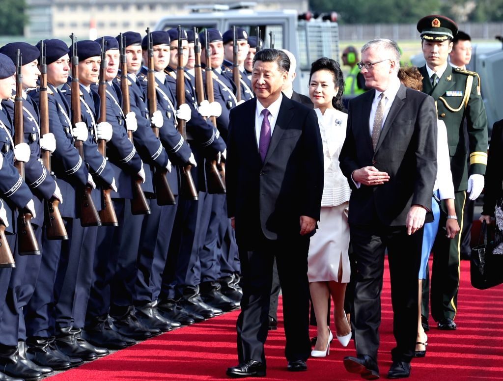 BERLIN, July 4, 2017 - Chinese President Xi Jinping and his wife Peng Liyuan are greeted upon their arrival in Berlin, Germany, July 4, 2017. Xi arrived here on Tuesday for his second state visit to ...