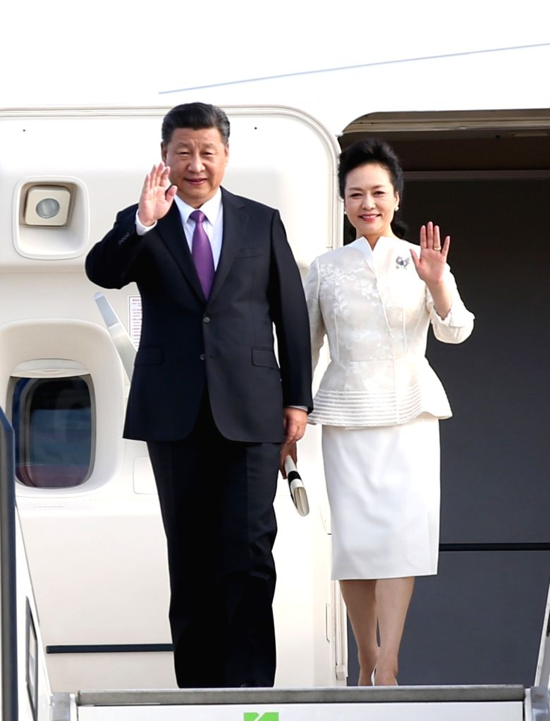 BERLIN, July 4, 2017 - Chinese President Xi Jinping and his wife Peng Liyuan wave upon their arrival in Berlin, Germany, July 4, 2017. Xi arrived here on Tuesday for his second state visit to Germany.