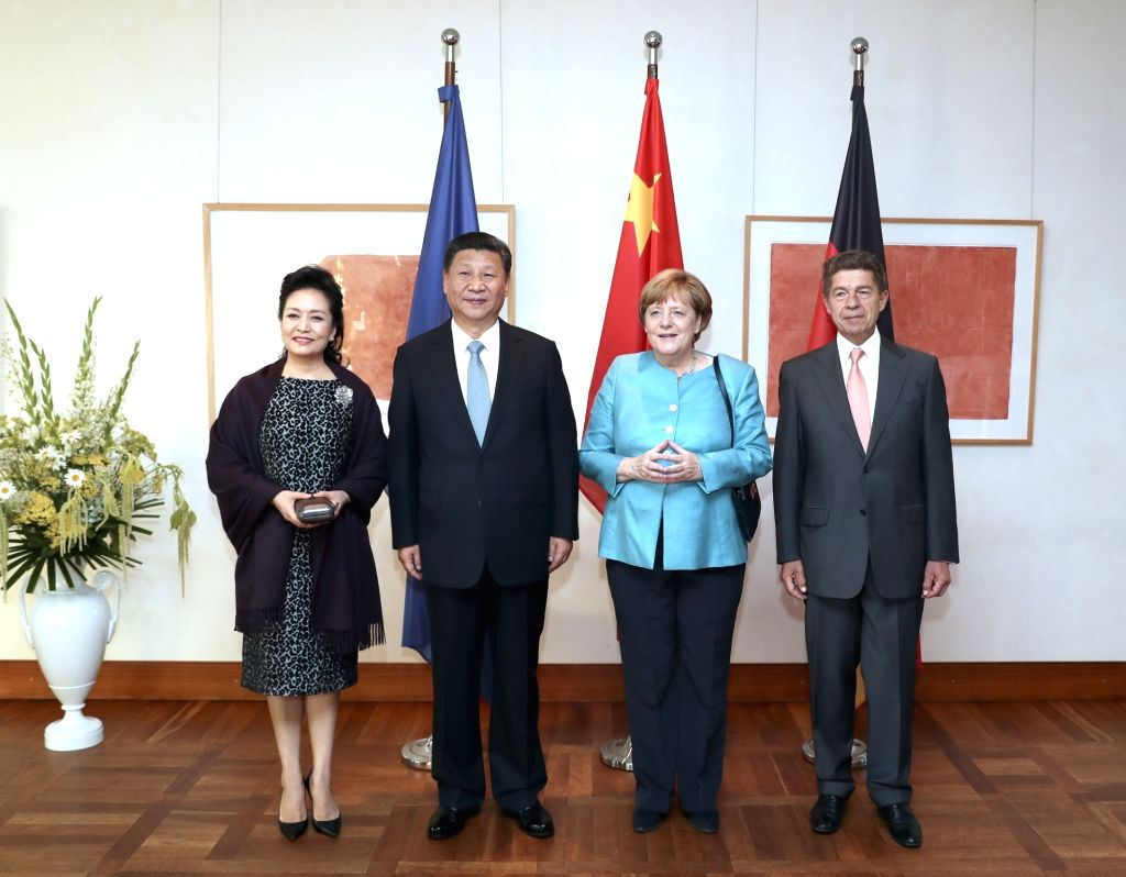 BERLIN, July 4, 2017 - Chinese President Xi Jinping (2nd L) and his wife Peng Liyuan (1st L) are greeted by German Chancellor Angela Merkel (2nd R) and her husband Joachim Sauer (1st R) at the Max ...