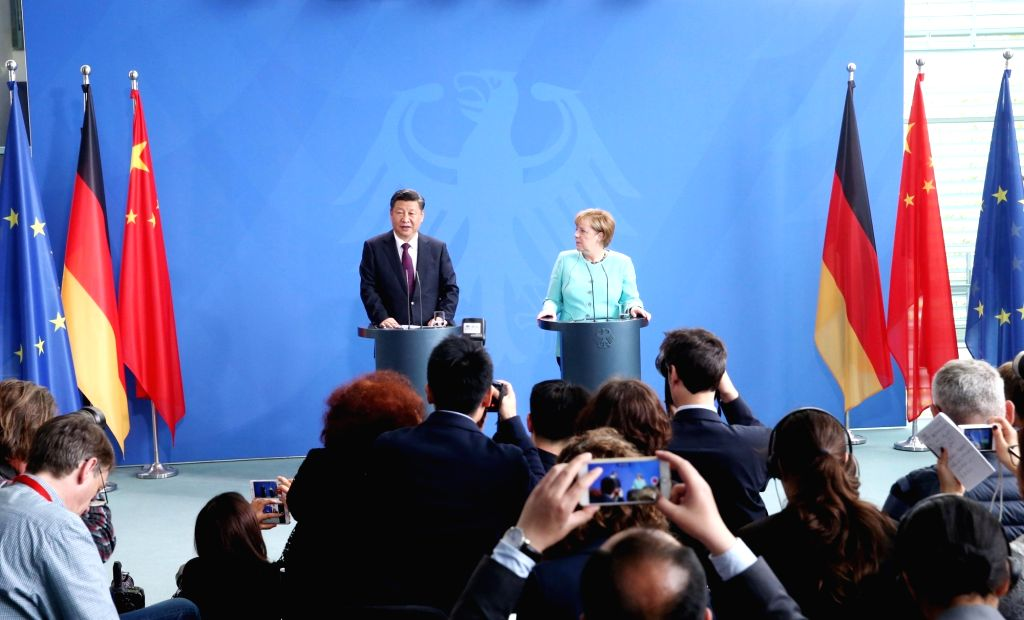 BERLIN, July 5, 2017 - Chinese President Xi Jinping (back, L) and German Chancellor Angela Merkel (back, R) attend a joint press conference after their talks in Berlin, capital of Germany, July 5, ...