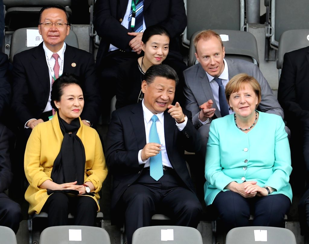 BERLIN, July 5, 2017 - Chinese President Xi Jinping (C, front), his wife Peng Liyuan (L, front) and German Chancellor Angela Merkel (R, front) watch a friendly football match between Chinese and ...