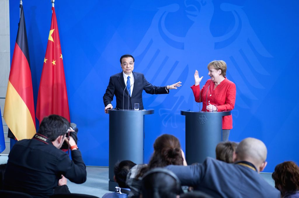 BERLIN, July 9, 2018 - Chinese Premier Li Keqiang (L) and German Chancellor Angela Merkel brief on results and answer questions from members of the press during a joint press conference after ...