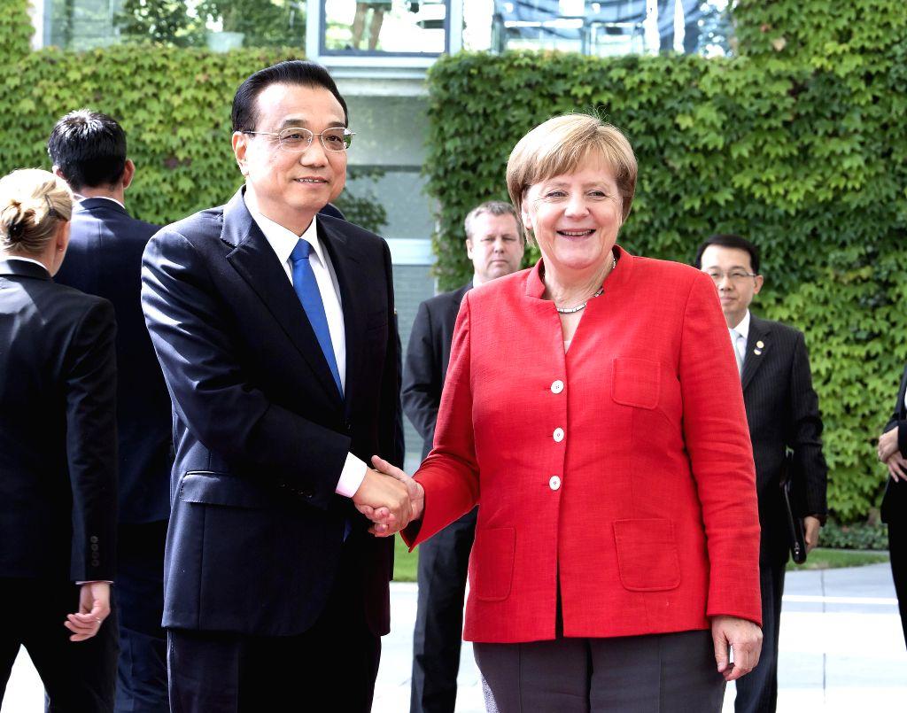 BERLIN, July 9, 2018 - Chinese Premier Li Keqiang (L) holds talks with German Chancellor Angela Merkel in Berlin, Germany, July 9, 2018. (Xinhua/Li Tao)