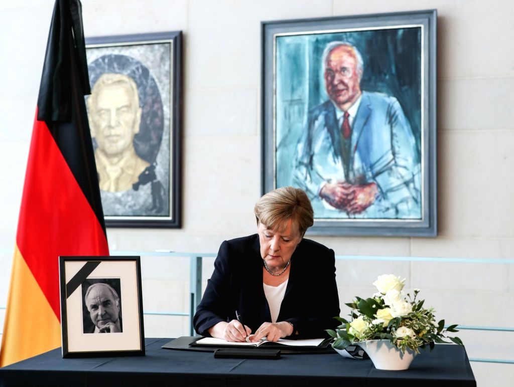 BERLIN, June 18, 2017 - German Chancellor Angela Merkel signs the condolences book for former German Chancellor Helmut Kohl at German Chancellery in Berlin, capital of Germany, on June 18, 2017. ...