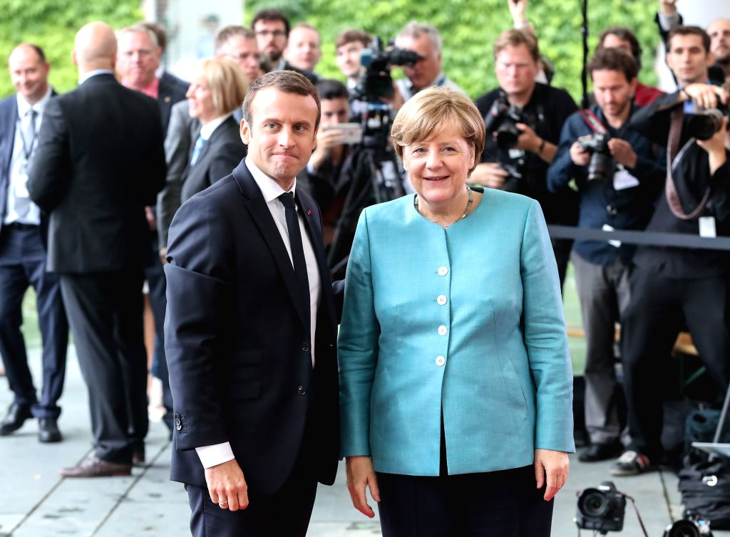 BERLIN, June 29, 2017 - German Chancellor Angela Merkel (R) poses for photos with French President Emmanuel Macron (L) before the preparation meeting for G20 at German Chancellery in Berlin, capital ...
