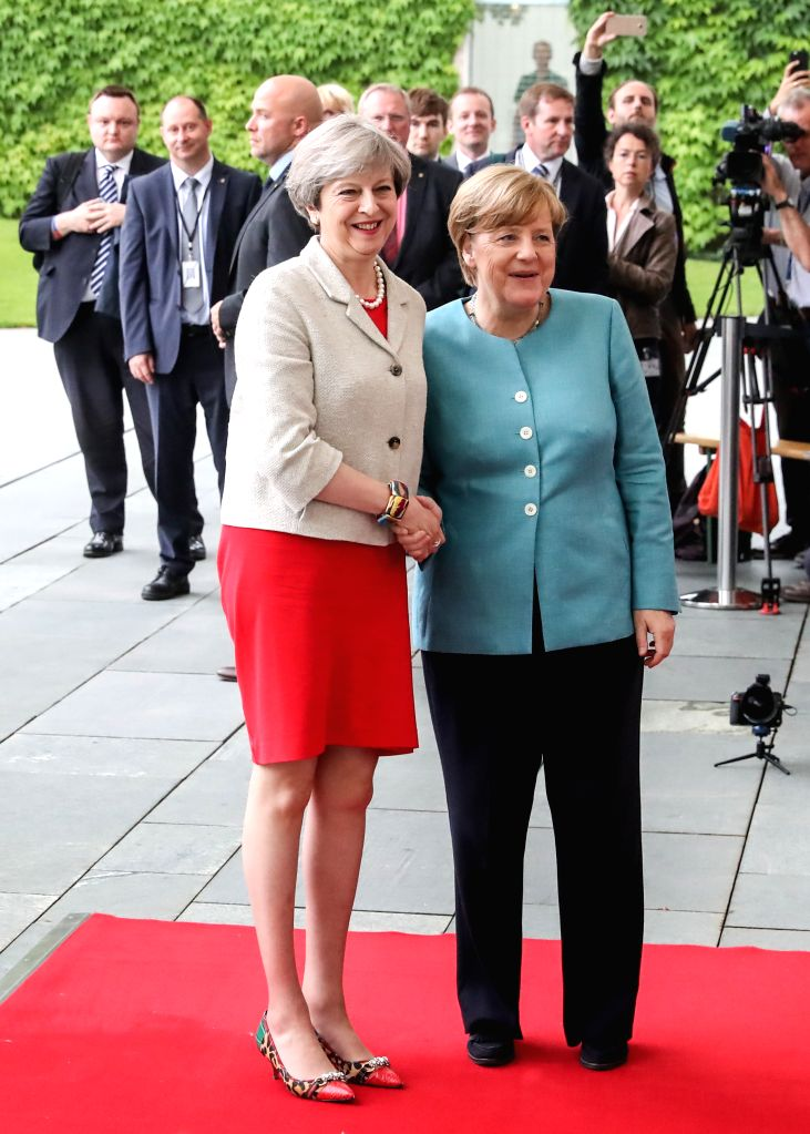 BERLIN, June 29, 2017 - German Chancellor Angela Merkel (R) poses for photos with British Prime Minister Theresa May (L) before the preparation meeting for G20 at German Chancellery in Berlin, ... - Theresa May