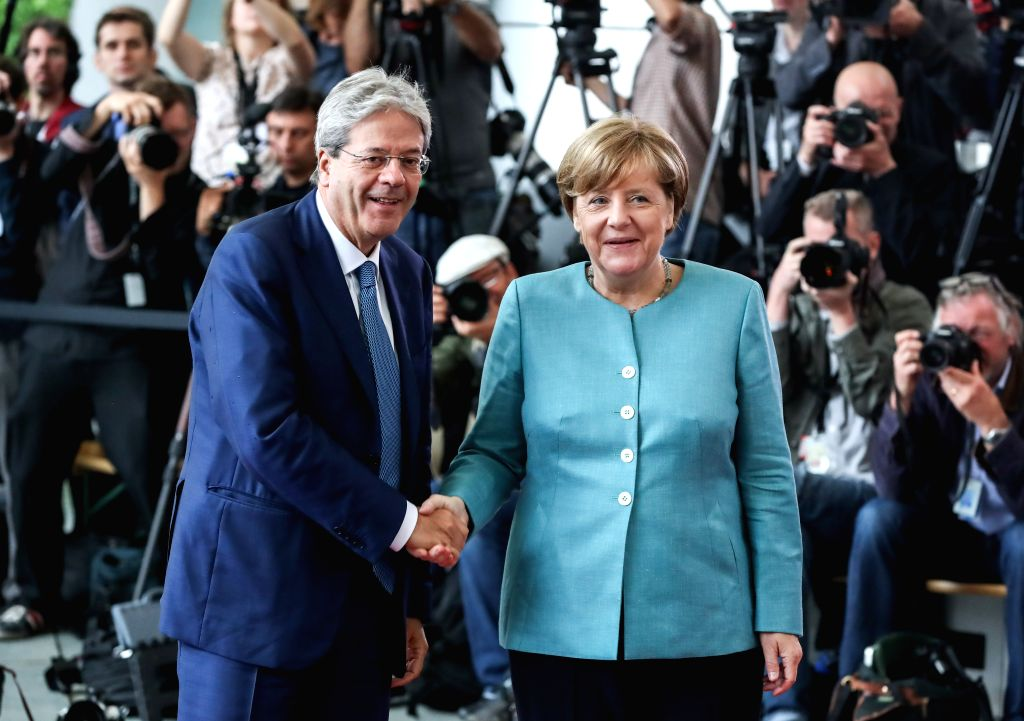 BERLIN, June 29, 2017 - German Chancellor Angela Merkel (R) poses for photos with Italian Prime Minister Paolo Gentiloni (L) before the preparation meeting for G20 at German Chancellery in Berlin, ... - Paolo Gentiloni
