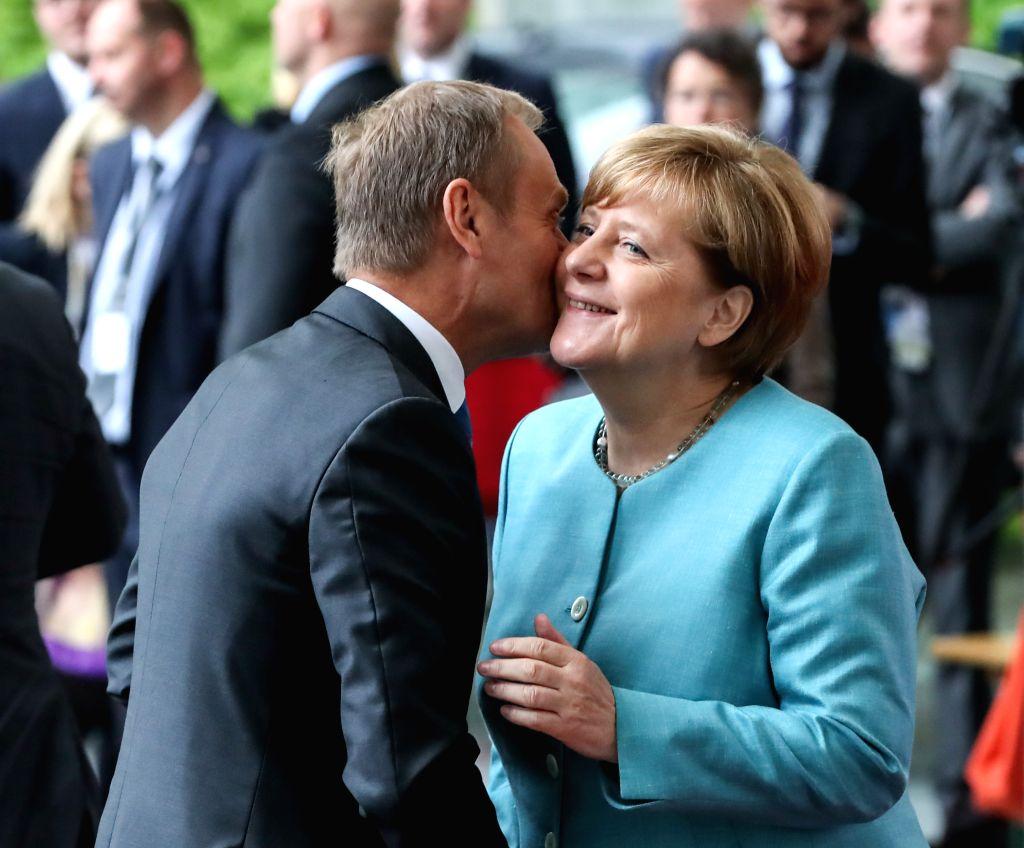 BERLIN, June 29, 2017 - German Chancellor Angela Merkel (R) greets President of the European Council Donald Tusk before the preparation meeting for G20 at German Chancellery in Berlin, capital of ...