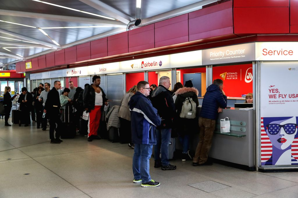 BERLIN, March 10, 2017 - Passengers gather at a service center of Air Berlin to get flights information at Tegel airport in Berlin, capital of Germany, on March 10, 2017. Ground staff at Berlin's two ...