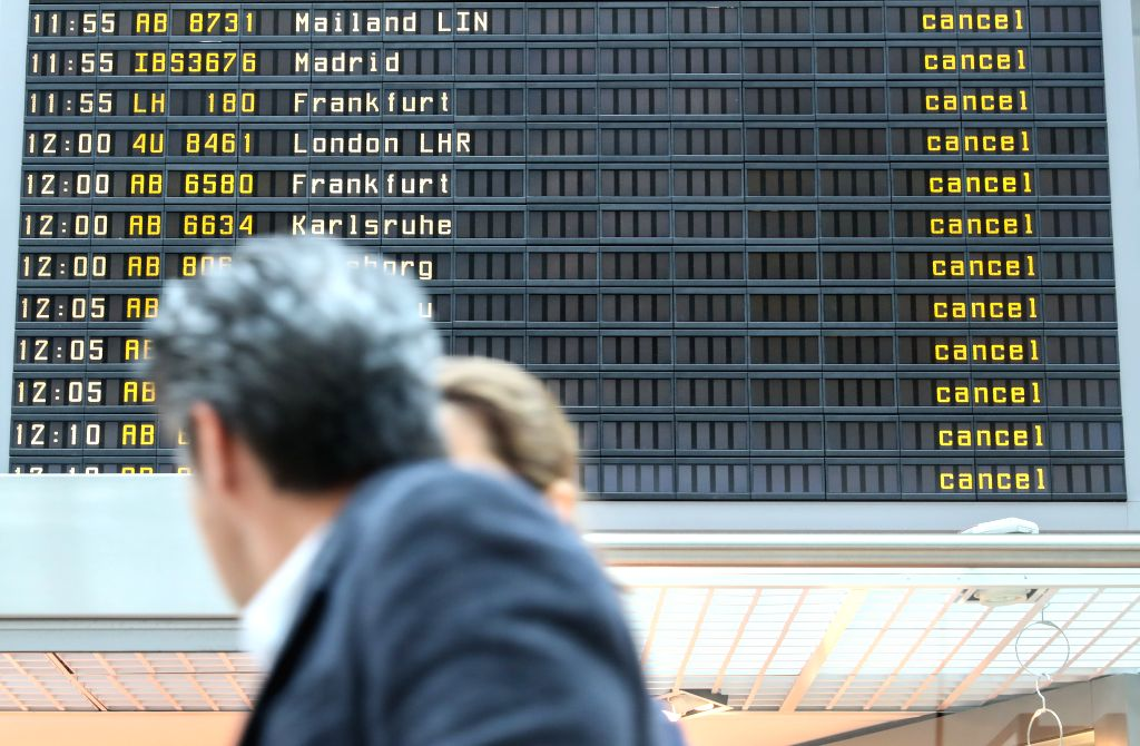 BERLIN, March 10, 2017 - Two passengers walk past an electronic screen showing cancelled flights at Tegel airport in Berlin, capital of Germany, on March 10, 2017. Ground staff at Berlin's two major ...