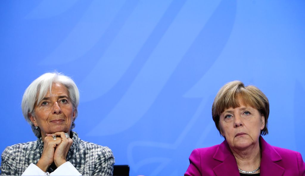 The International Monetary Fund (IMF) Managing Director Christine Lagarde (L) and German Chancellor Angela Merkel attend a joint press conference after a meeting at ...
