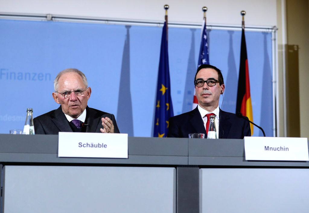 BERLIN, March 16, 2017 - German Finance Minister Wolfgang Schaeuble (L) and visiting U.S. Treasury Secretary Steven Mnuchin attend a joint press conference after their meeting in Berlin, capital of ... - Wolfgang Schaeuble