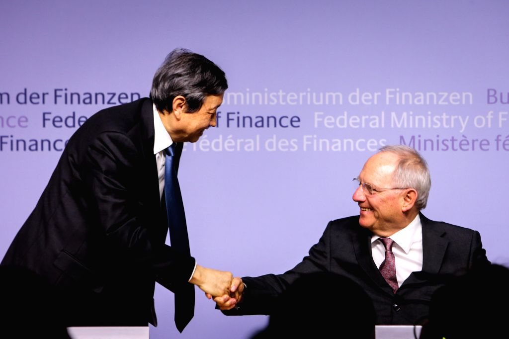 Chinese Vice Premier Ma Kai (L) shakes hands with German Finance Minister Wolfgang Schaeuble during a press conference in Berlin, capital of Germany, on March 17, ... - Wolfgang Schaeuble