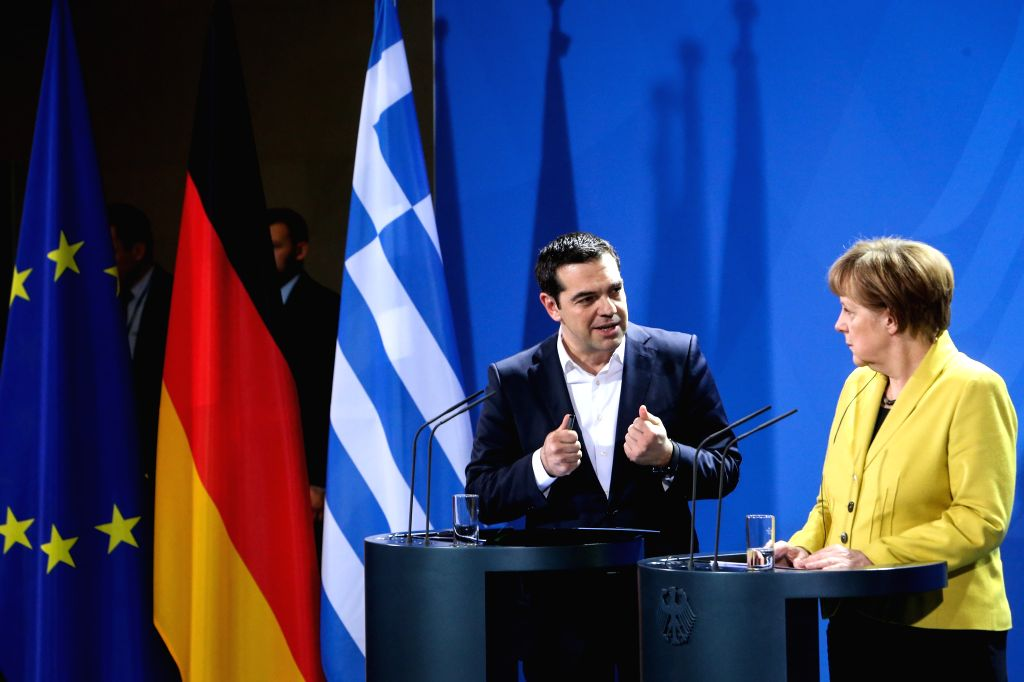 German Chancellor Angela Merkel (R) and Greek Prime Minister Alexis Tsipras attend a joint press conference after their meeting at the Chancellery in Berlin, ... - Alexis Tsipras