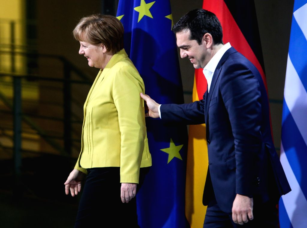German Chancellor Angela Merkel (L) and Greek Prime Minister Alexis Tsipras attend a joint press conference after their meeting at the Chancellery in Berlin, ... - Alexis Tsipras