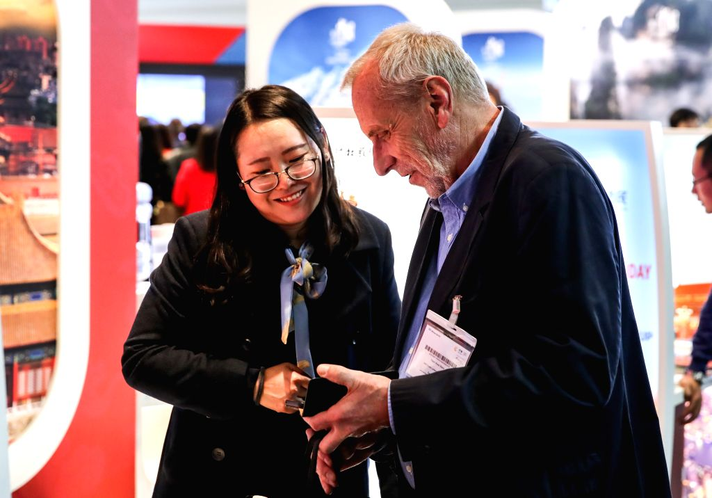 BERLIN, March 6, 2019 - A visitor talks with a staff member at the booth of China during the ITB Berlin travel trade show in Berlin, capital of Germany, on March 6, 2019. The ITB Berlin travel trade ...