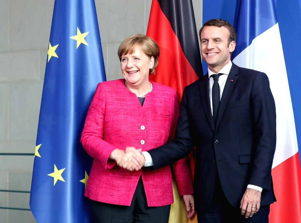 BERLIN, May 15, 2017 - German Chancellor Angela Merkel (L) shakes hands with visiting French President Emmanuel Macron after a joint press conference in Berlin, capital of Germany, on May 15, 2017.