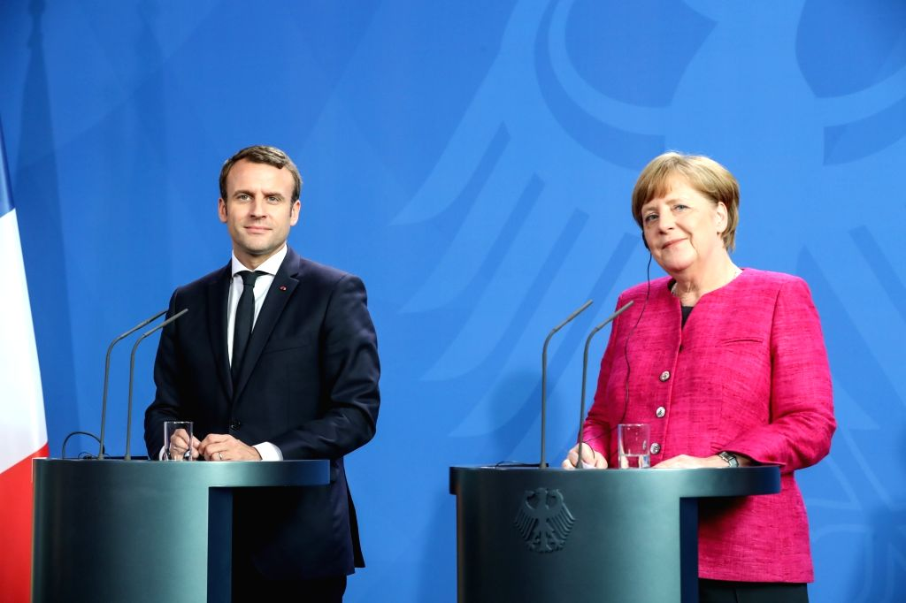 BERLIN, May 15, 2017 - German Chancellor Angela Merkel (R) and visiting French President Emmanuel Macron attend a joint press conference in Berlin, capital of Germany, on May 15, 2017.