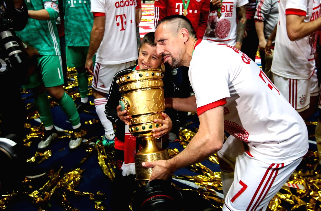 BERLIN, May 26, 2019 - Bayern Munich's Franck Ribery (front) poses for photos holding the trophy with his son after the German Cup final between RB Leipzig and FC Bayern Munich in Berlin, capital of ...