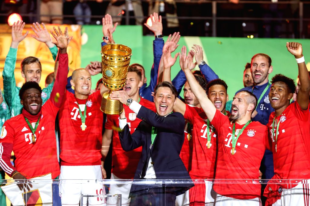 BERLIN, May 26, 2019 - Bayern Munich's head coach Niko Kovac (C) holds the trophy during the award ceremony for the German Cup final between RB Leipzig and FC Bayern Munich in Berlin, capital of ...