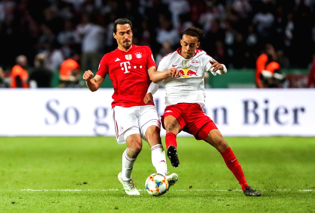 BERLIN, May 26, 2019 - Bayern Munich's Mats Hummels (L) vies with Leipzig's Yussuf Poulsen the German Cup final between RB Leipzig and FC Bayern Munich in Berlin, capital of Germany, May 25, 2019. ...